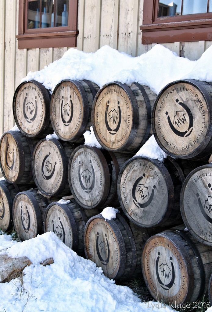 Discarded whisky barrels covered in snow.