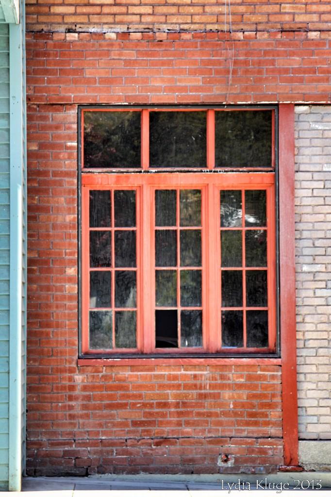 A missing windowpane catches my eye.