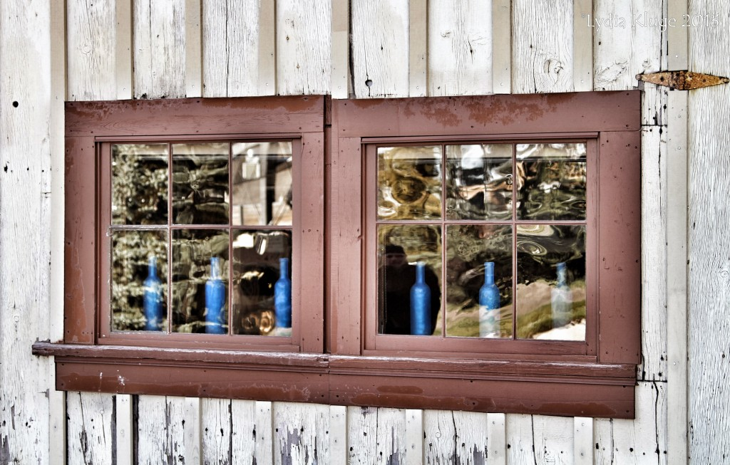 Blue bottles lined up in the window of High West distillery.