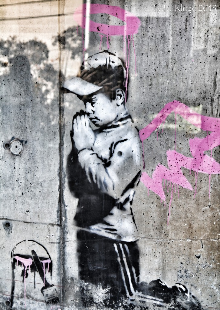 The work of English graffiti artist Banksy brightens a wall in Old Town.