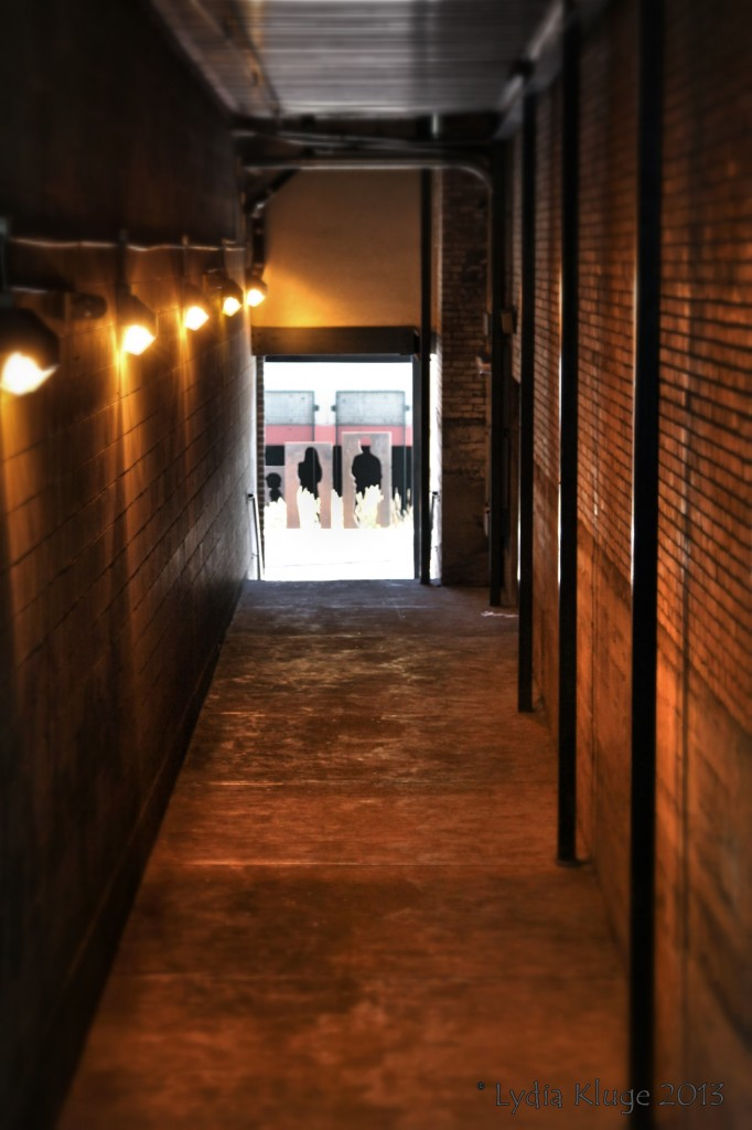 Cut out figures align with the end of an alleyway.